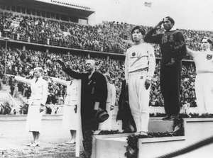 Jesse Owens podium winners gold medal 1936 1936
